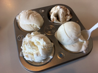 Four cupcake holder filled with ice cream scoops